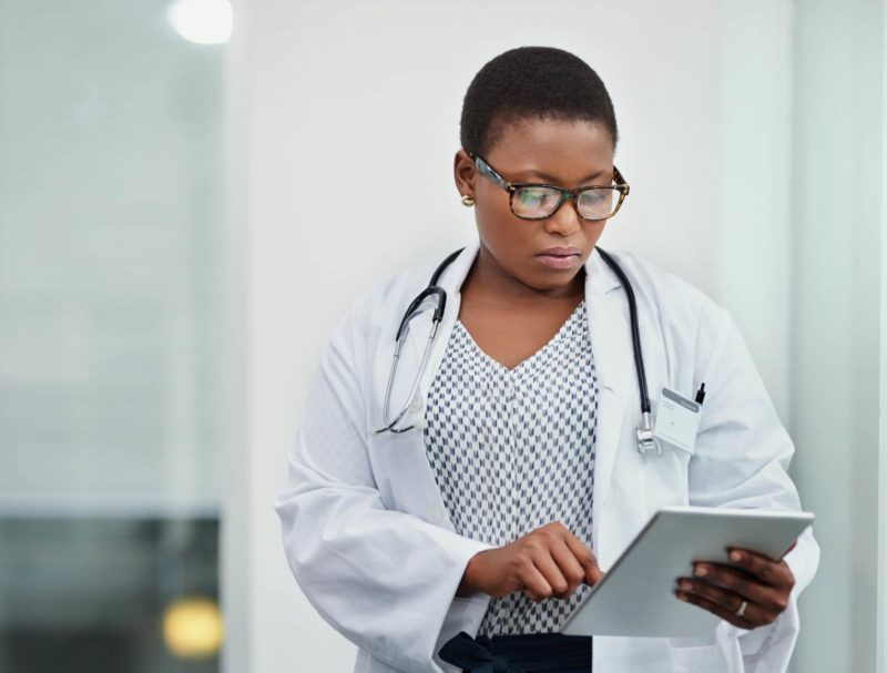 Doctor using a digital tablet in a hospital